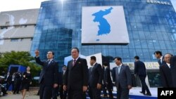 In this Sept. 14, 2018, file photo, South Korea's Unification Minister Cho Myoung-gyon, center left, and Ri Son Gwon, chairman of the North's Committee for the Peaceful Reunification, center right, attend at an opening ceremony for two Koreas' first liaison office in Kaesong, North Korea. (Korea Pool/Yonhap via AP, File)