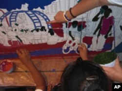 Tony Ortega takes part in visiting artist programs and recently enlisted children to help him create a wall-sized mural about their neighborhood.