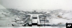 Airplanes stand in the snow at O'Hare International Airport, Feb. 1, 2015, in Chicago.