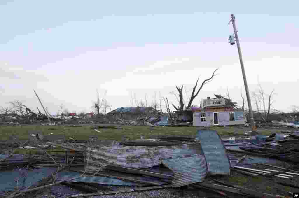 Residents of Marysville, Indiana, survey the tornado damage to their homes, March 2, 2012. (AP)