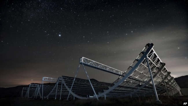 This November 2016 photo provided by the Canadian Hydrogen Intensity Mapping Experiment collaboration shows the CHIME radio telescope at the Dominion Radio Astrophysical Observatory in Kaleden, British Columbia, Canada. (Andre Renard/University of Toront
