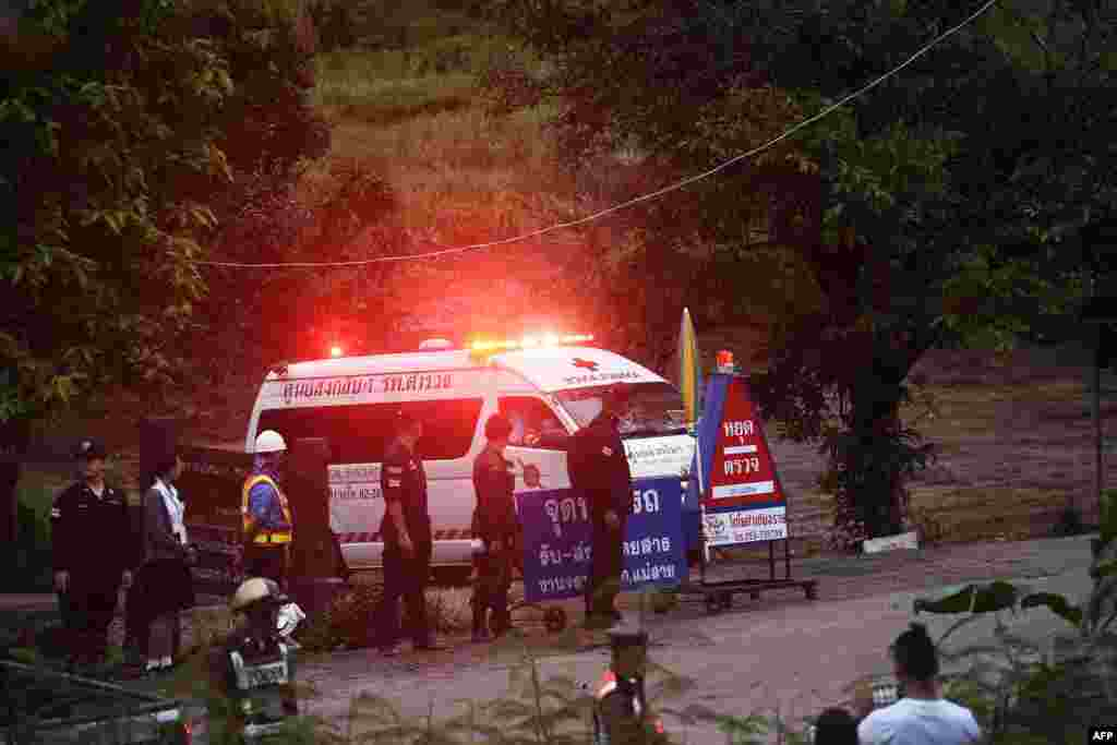 An ambulance leaves the Tham Luang cave area after divers evacuated some of the 12 boys and their coach trapped at the cave in Khun Nam Nang Non Forest Park in the Mae Sai district of Chiang Rai province, July 8, 2018.