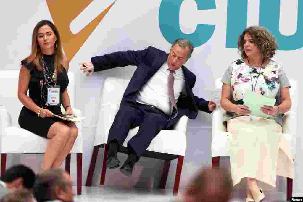 Institutional Revolutionary Party (PRI) presidential candidate Jose Antonio Meade reacts while falling off his chair after arriving to a meeting with citizens in Mexico City, Mexico, May 29, 2018.