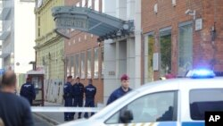 FILE - Police officers stand in front of the entrance of the Church of Scientology of Budapest headquarters in Vaci Road in Budapest, Hungary, Wednesday, Oct. 18, 2017.