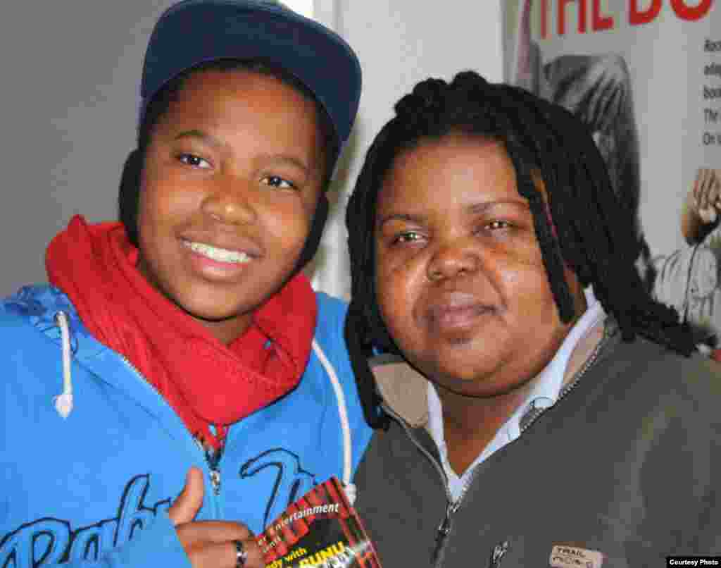 A fan poses for a photograph with Bunu after a recent show in Johannesburg [Photo: Darren Taylor]