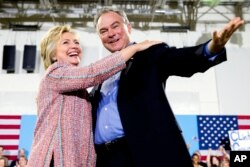 FILE - Democratic presidential candidate Hillary Clinton, accompanied by Sen. Tim Kaine, D-Va., speaks at a rally in Annandale, Va., July 14, 2016.