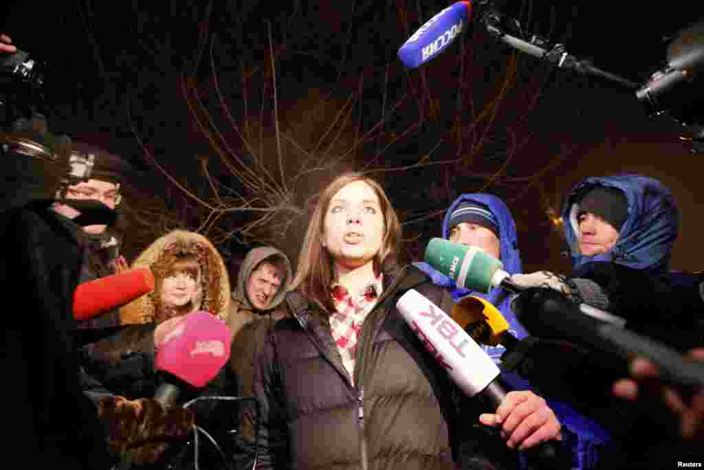 Pussy Riot member Nadezhda Tolokonnikova speaks to the media after she was released from prison in Krasnoyarsk, Russia, Dec. 23, 2013.