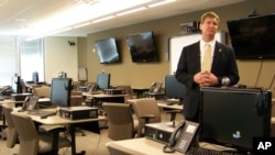 FILE - FBI spokesman Kyle Loven gives a tour of the Emergency Operations Center at the new Minneapolis-area field office in Brooklyn Center, Minnesota, March 9, 2012.