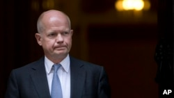 Britain's Foreign Secretary William Hague leaves 10 Downing street following a national security meeting at Downing Street in London, Aug. 28, 2013.