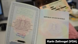 A national ID, shown behind this South Sudanese passport, is required for getting a job or applying to university in South Sudan.