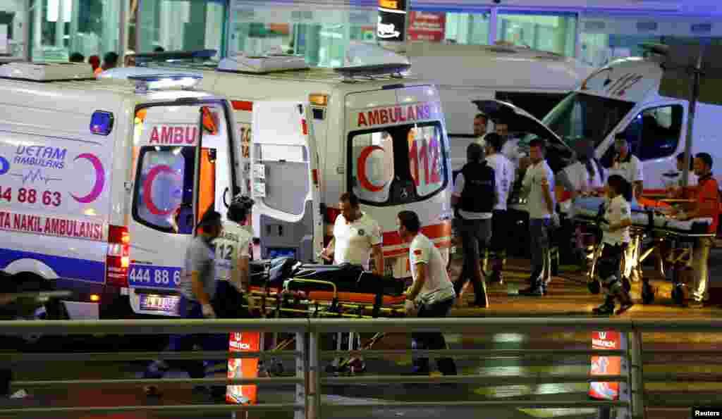 Paramedics push a stretcher at Turkey's largest airport, Istanbul Ataturk, following a blast in Turkey, June 28, 2016.