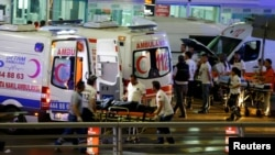 FILE - Paramedics push a stretcher at Turkey's largest airport, Istanbul Ataturk, following a blast in Turkey, June 28, 2016.