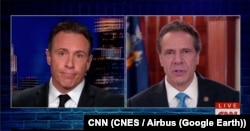 Chris Cuomo (L) interviews his brother, Governor Mario Cuomo of New York, on his CNN news program.