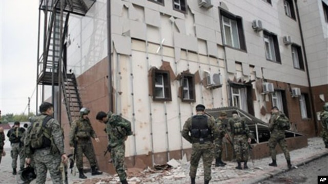 Special Force (OMON) officers  in front of Chechen parliament complex after a bomb blast in Grozny, Chechnya, 19 Oct 2010.