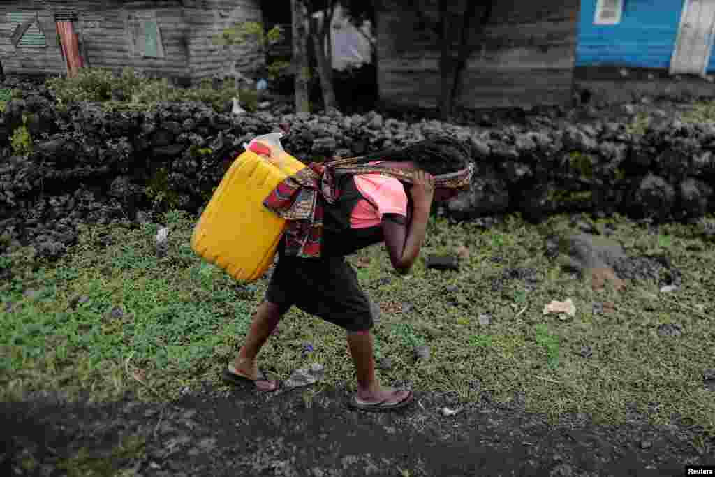 Chikuru, 11, carries water home in Bugamba district in Goma, the capital of North Kivu, eastern Democratic Republic of Congo, Sept. 30, 2019.