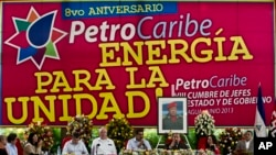 FILE - Under a portrait of the late Hugo Chavez, Venezuela's President Nicolas Maduro, fourth from right, and Nicaragua's President Daniel Ortega, third from right, preside over 8th Petrocaribe Summit in Managua, Nicaragua, June 29, 2013.