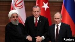 Tổng thống Iran Hassan Rouhani (trái) Tổng thống Thổ Nhĩ Kỳ Recep Tayyip Erdogan và Tổng thống Nga Vladimir Putin tại cuộc họp báo chung ở Ankara, Thổ Nhĩ Kỳ, ngày 4/4/2018.