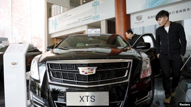 Customer Wang Pan looks around Cadillac's XTS model at its dealership in Beijing, China, March 14, 2016.