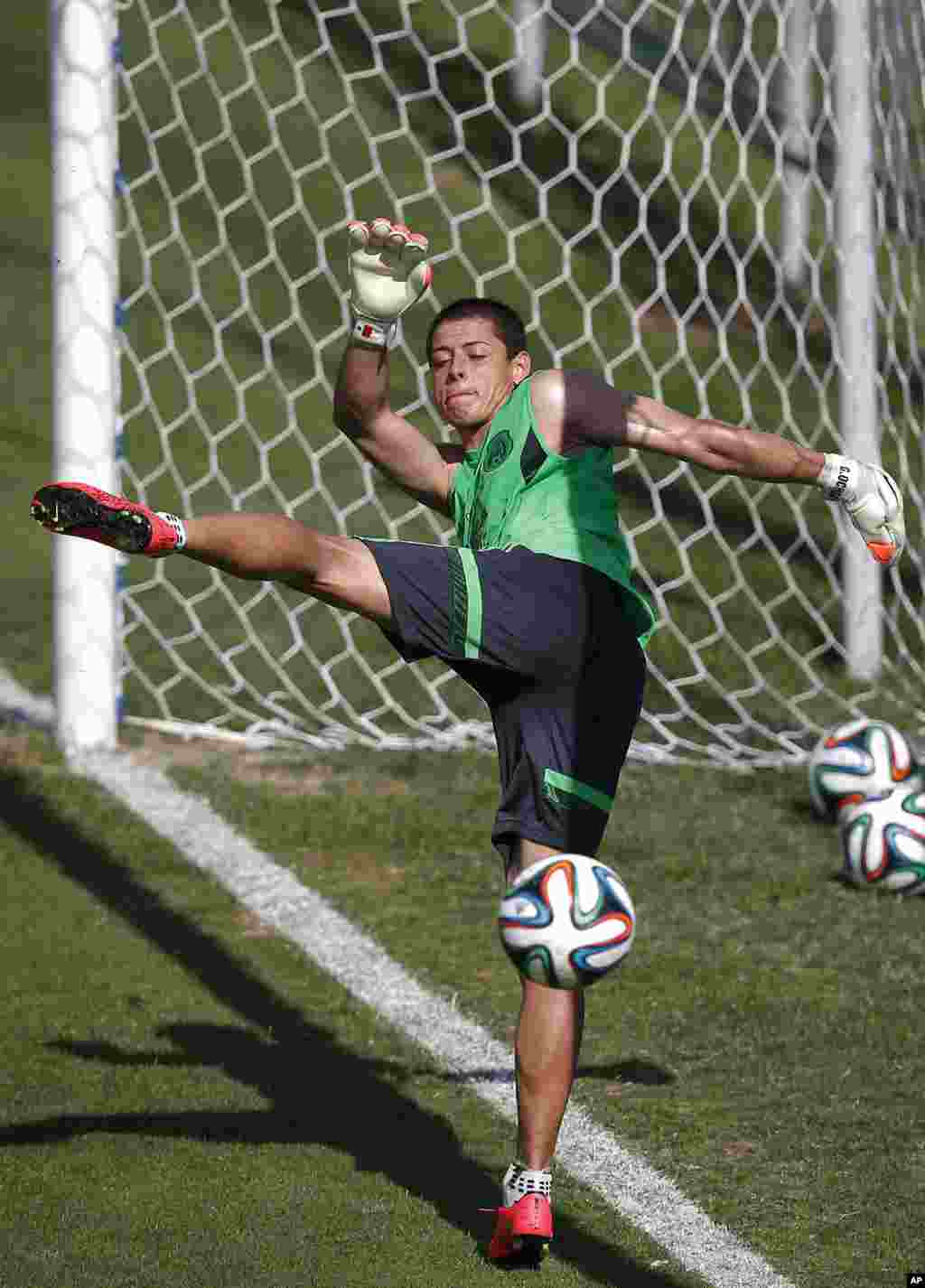 Mexico's national soccer player Javier Hernandez kicks the ball during a training session in Santos, Brazil, June 8, 2014.