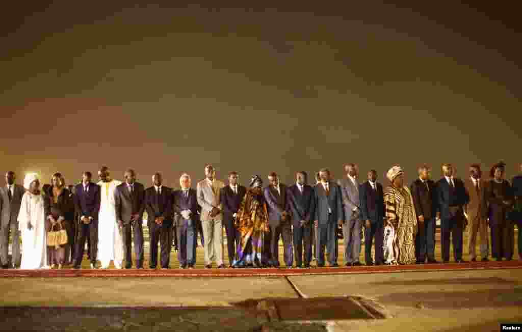 Members of Senegal's government wait to greet U.S. President Barack Obama in Dakar, June 26, 2013.