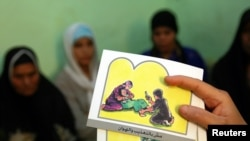 Cards are used to teach women about female genital mutilation.