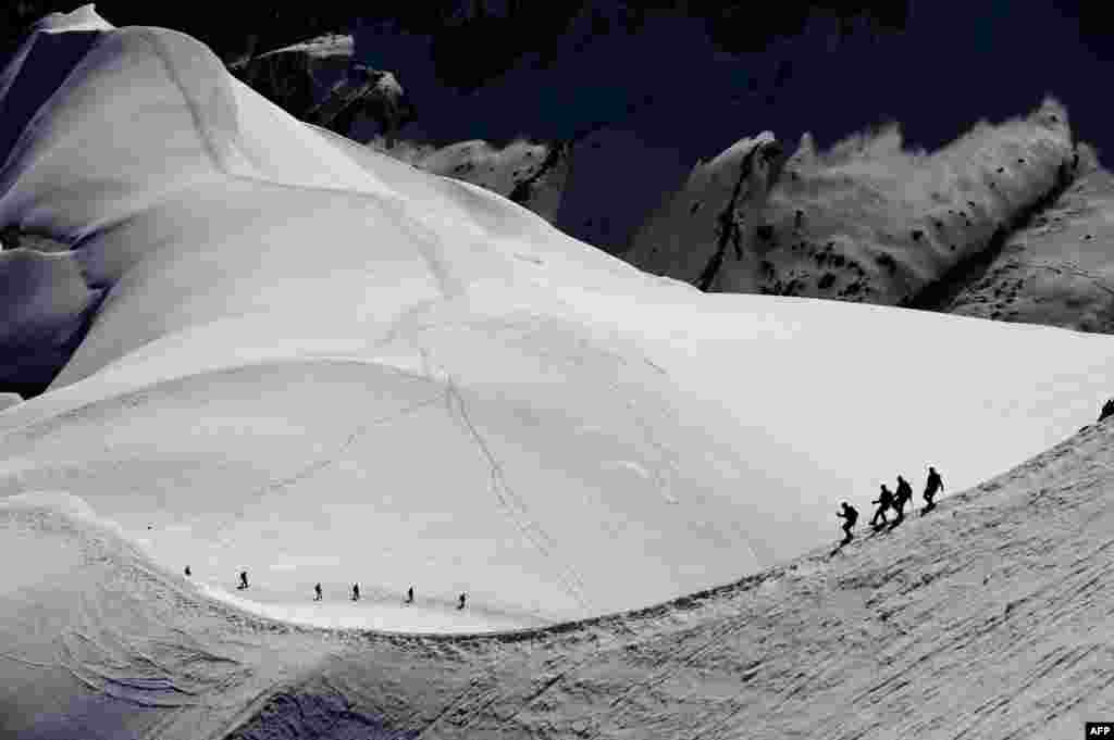 Alpinists walk on the Mont-Blanc Massif above the Vallee Blanche in the French Alps.
