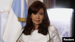 FILE - Argentina's President Cristina Fernandez de Kirchner speaks during a ceremony at the Casa Rosada Presidential Palace in Buenos Aires, July 31, 2014.