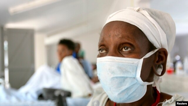 FILE 0 A patient who tested positive for extreme drug resistant tuberculosis (XDR-TB) awaits treatment at a rural hospital at Tugela Ferry in South Africa's impoverished KwaZulu Natal province.