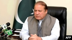 An handout picture released by the Pakistan Press Information Department (PID), March 28, 2016, shows Pakistan's Prime Minister Nawaz Sharif addressing the nation at his office in Islamabad.
