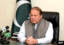 FILE - An handout picture released by the Pakistan Press Information Department (PID), March 28, 2016, shows Pakistan's Prime Minister Nawaz Sharif addressing the nation at his office in Islamabad.
