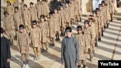 FILE - А screen grab from an Islamic State propaganda video shows child soldiers, known as cubs of the caliphate, at an alleged IS training camp.