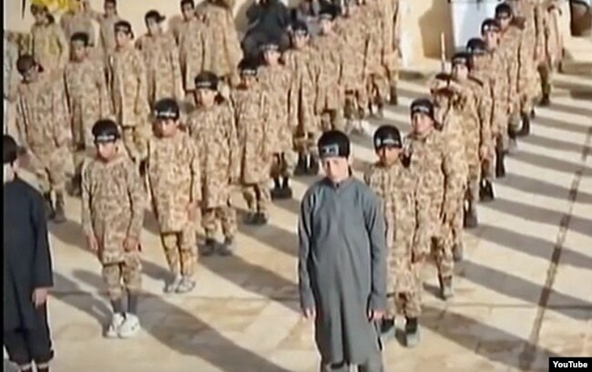 А YouTube screen grab from an undated Islamic State propaganda video shows child soldiers at an alleged IS training camp. Many of the children were reportedly taken from captured families and civilians living in formerly IS-controlled areas.