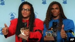 FILE - Rob Pilatus, left, and Fab Morvan of Milli Vanilli give the thumbs-up as they display their Grammys after being presented with the best new artist award in Los Angeles, Feb. 21, 1990.
