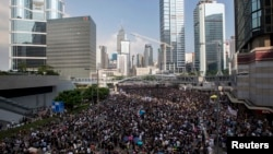 Protesters block the main road to the financial Central district in Hong Kong, Sept. 29, 2014.