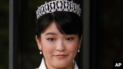 FILE - Japan's Princess Mako, the first daughter of Prince Akishino and Princess Kiko, poses for photos at Imperial Palace in Tokyo. Mako, the granddaughter of Emperor Akihito, is getting married to an ocean lover who can ski, play the violin and cook, according to public broadcaster NHK TV. The Imperial Household Agency declined to confirm the report Tuesday, May 16, 2017.