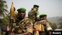 Soldiers from the AU peacekeeping mission prepare to leave at the end of a speech given by Alexandre-Ferdinand Nguendet, the head of Central African Republic's transitional assembly at the Gendarmerie headquarters in Bangui on Jan. 13, 2014.