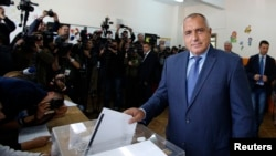 Boyko Borisov, leader of Bulgaria's center right GERB party, casts his vote in Sofia Oct. 5, 2014.