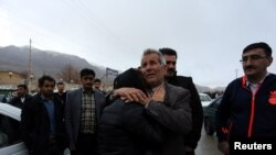 Relatives of a passenger who was believed to have been killed in a plane crash react near the town of Semirom, Iran, Feb. 18, 2017. (REUTERS/Tasnim News Agency)