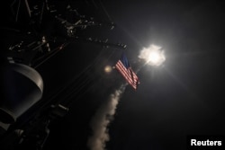 FILE - U.S. Navy guided-missile destroyer USS Porter (DDG 78) conducts strike operations while in the Mediterranean Sea which U.S. Defense Department said was a part of cruise missile strike against Syria, April 7, 2017.