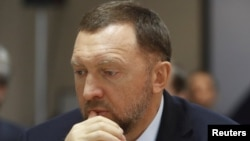 FILE - Oleg Deripaska attends an agreement-signing ceremony with the Krasnoyarsk region's government in Moscow, Russia, Dec. 12, 2017.