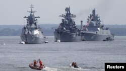 Russian warships are seen anchored in a bay of the Russian fleet base in Baltiysk in Russia's Kaliningrad region between Poland and the Baltic states, July 19, 2015.