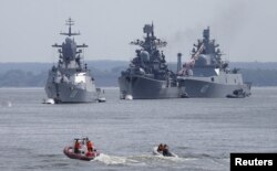 FILE - Russian war ships are seen anchored in a bay of the Russian fleet base in Baltiysk in Russia's Kaliningrad region between Poland and the Baltic states, July 19, 2015.
