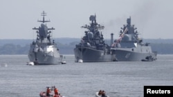 Russian war ships are seen anchored in a bay of the Russian fleet base in Baltiysk in Russia's Kaliningrad region between Poland and the Baltic states, July 19, 2015.