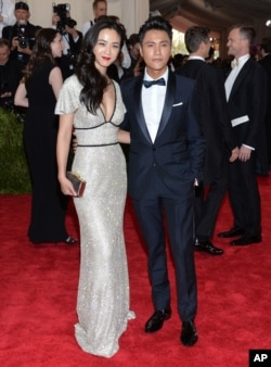 "Tang Wei, left, and Chen Kun arrive at The Metropolitan Museum of Art's Costume Institute benefit gala celebrating ""China: Through the Looking Glass"" on May 4, 2015, in New York."