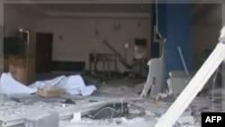 Hình ảnh chiếu trên đài truyền hình của nhà nước ngày 6/11/2011 cho thấy tòa nhà bị hư hỏng tại Damatura, Nigeria sau một loạt các cuộc tấn công phối hợp giết chết ít nhất 69 người