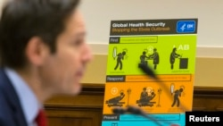 FILE - U.S. Centers for Disease Control and Prevention (CDC) Director Tom Frieden displays CDC educational materials as he testifies about the Ebola crisis in West Africa during a hearing of a House Foreign Affairs subcommittee on Capitol Hill in Washingt