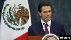 FILE - Mexico's President Enrique Pena Nieto talks during an official swearing-in ceremony for new ministers at the Los Pinos official residence in Mexico City, Aug. 27, 2015.