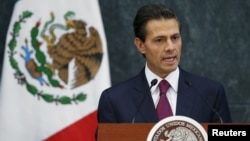 FILE -Mexico's President Enrique Pena Nieto talks during an official swearing-in ceremony for new ministers at the Los Pinos official residence in Mexico City, Aug. 27, 2015.