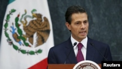 Mexico's President Enrique Pena Nieto talks during an official swearing-in ceremony for new ministers at the Los Pinos official residence in Mexico City, Aug. 27, 2015. Peno Nieto's approval rating sank to a new low in a poll released by Buendia & Laredo.