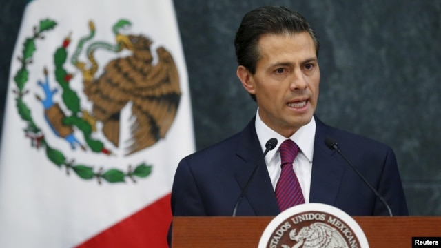 FILE - Mexico's President Enrique Pena Nieto speaks at the Los Pinos official residence in Mexico City, Aug. 27, 2015.